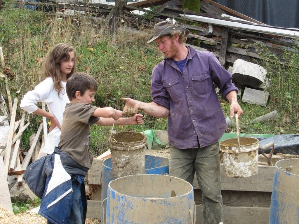 Kids helping with mud buckets